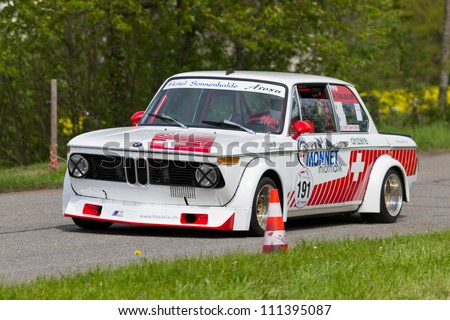 MUTSCHELLEN, SWITZERLAND-APRIL 29: Vintage race touring car BMW 2002 Tii from 1972 at Grand Prix in Mutschellen, SUI on April 29, 2012.  Invited were vintage sports cars and motorbikes. - stock photo