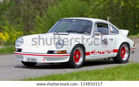 MUTSCHELLEN, SWITZERLAND-APRIL 29: Vintage race touring car Porsche Carrera RS 2.7 from 1973 at Grand Prix in Mutschellen, SUI on April 29, 2012.  Invited were vintage sports cars and motorbikes. - stock photo