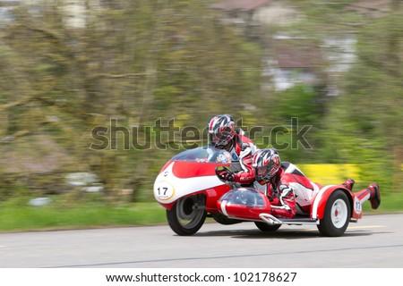 MUTSCHELLEN, SWITZERLAND-APRIL 29: Vintage sidecar motorbike BMW Kneeler  from 1962 at Grand Prix in Mutschellen, SUI on April 29, 2012.  Invited were vintage sports cars and motorbikes. - stock photo