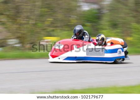 MUTSCHELLEN, SWITZERLAND-APRIL 29: Vintage sidecar motorbike Flueckiger/Graf FRG 500 from 1981 at Grand Prix in Mutschellen, SUI on April 29, 2012.  Invited were vintage sports cars and motorbikes. - stock photo