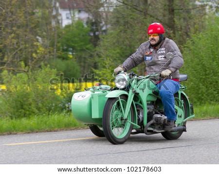 MUTSCHELLEN, SWITZERLAND-APRIL 29: Vintage sidecar motorbike Z���¼ndapp KS 600 from 1941 at Grand Prix in Mutschellen, SUI on April 29, 2012.  Invited were vintage sports cars and motorbikes. - stock photo