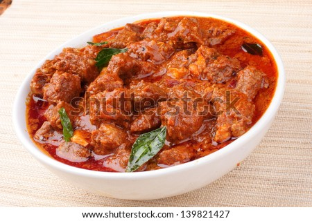 mutton curry.delicious Kerala style meat curry. It goes well well with ghee rice, appam, parotta, puttu and chappathi. - stock photo