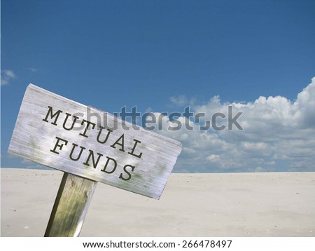 Mutual funds sign with clouds and skyline background - stock photo