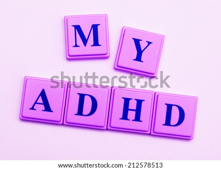 My ADHD spelled out in pink block letters - stock photo