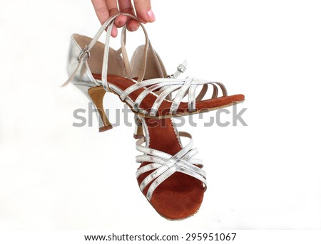My favorite silver dancing shoes with high heels with white in the background - stock photo
