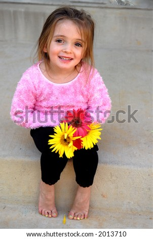 My Flowers - A little girl so proud of her flowers - stock photo