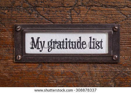 My gratitude list - a label on a grunge wooden file cabinet - stock photo