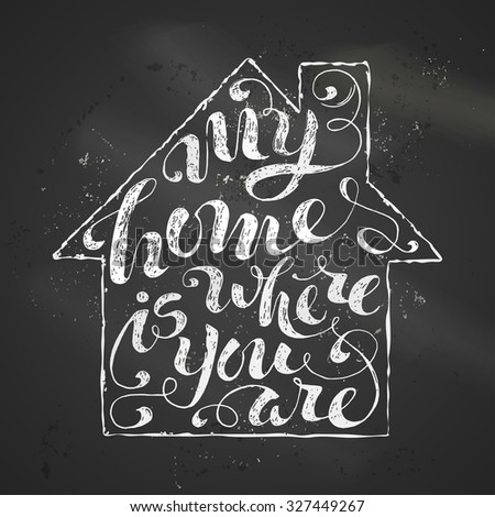 My Home Is Where You Are. Chalk phrase on blackboard background in home contour. - stock photo
