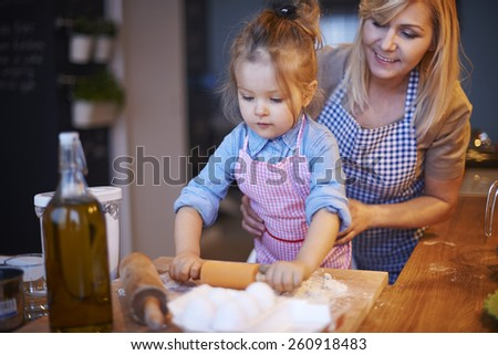 My little baker in the kitchen  - stock photo