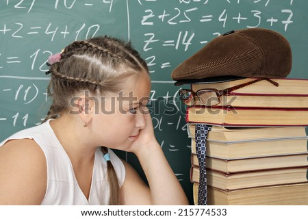 My teachers it is my books, schoolgirl looking into the eyes of his teacher - stock photo