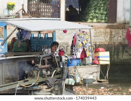 MY THO, VIETNAM - DECEMBER 29: Slum on the bank of Mekong river on December 29, 2013 in My Tho, Vietnam. - stock photo