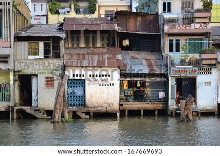 MY THO, VIETNAM - FEBRUARY 13: Houses on the bank of Mekong river on February 13, 2012 in My Tho, Vietnam. - stock photo