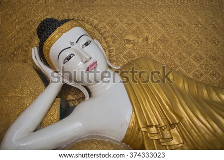 Myanmar style reclining Buddha statue in temple - stock photo