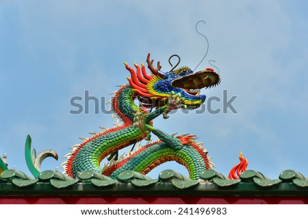 Myanmar. This colorful dragon is on the rooftop of the Kheng Hock Keong Buddhist  Temple in China Town in Yangon./	Dragon on the roof of a Chinese temple in Yangon, Myanmar - stock photo