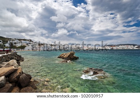 Mykonos city with yacht harbor, beach, villas and houses - stock photo
