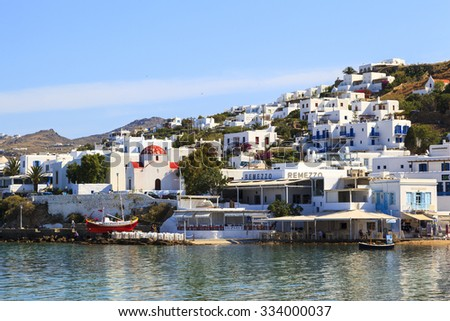MYKONOS GREECE - May 24 2014 : Boats are mooring at Mykonos waterfront. Mykonos is the most popular Greek island, known for non-stop party island. Mykonos is European popular destination for tourism. - stock photo