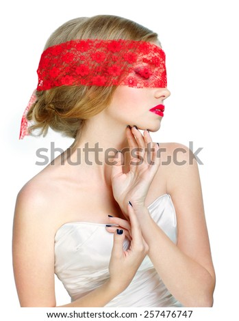 Mysterious beautiful blonde with ribbon on eyes - stock photo