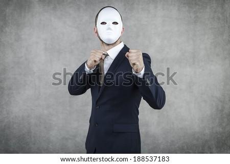 mysterious businessman ready to fight - stock photo
