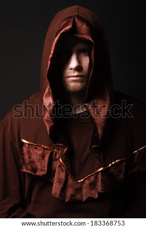 mysterious Catholic monk. studio shot - stock photo