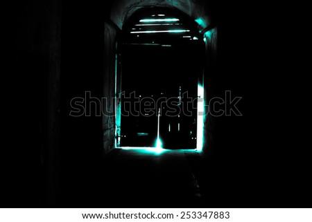 Mysterious door, secret entrance or exit blue light - stock photo