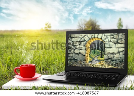 Mysterious entrance to new life or beginning. Step to new opportunities. The entrance to another world. Journey to fairytale. Laptop and a cup of hot coffee outdoors. Travel concept. Beautiful nature. - stock photo