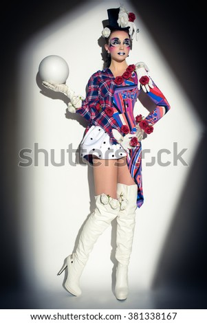 mysterious female jester Masquerade  character  holding ball - stock photo