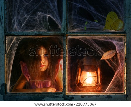 Mysterious girl staring out the window - stock photo