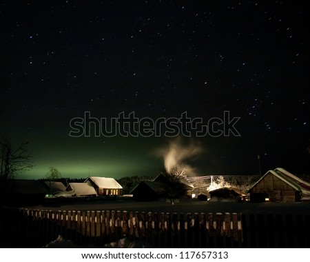 Mysterious light in Christmas night.  Winter rural landscapes - stock photo