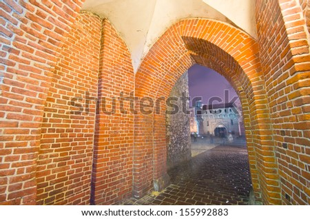 mysterious narrow alley in Krakow at night - stock photo