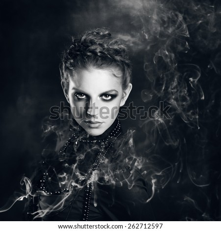 Mysterious portrait  beautiful females  in the smoke - stock photo