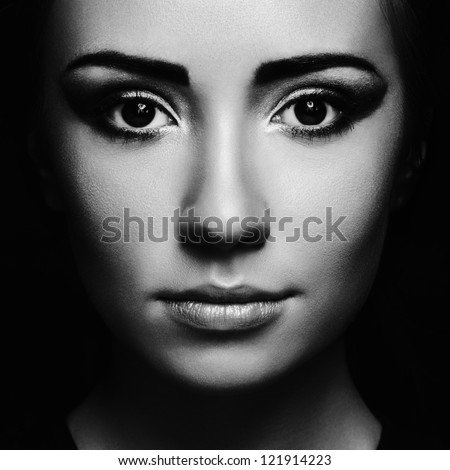 Mysterious portrait of a beautiful young woman. Black and white photo - stock photo