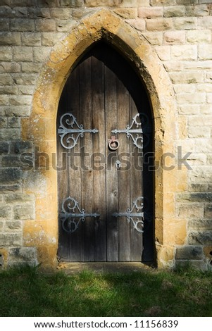 Mysterious semi-circular doorway dappled with a shadowy light - stock photo