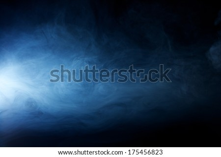 Mysterious, Solemn, Hazy fog patterns lit by a beam of light - stock photo