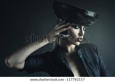 mysterious woman in black with ring - stock photo