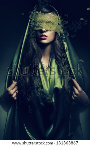 mysterious woman in green leaves bandage - stock photo