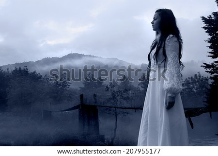 Mysterious Woman in White Dress, vintage filter - stock photo