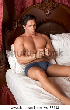 mystery handcuffed man in bed - stock photo