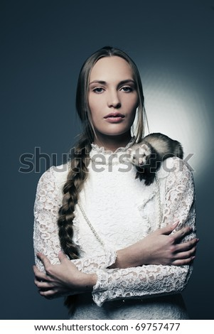 mystic beautiful girl with domestic ferret on her shoulder - stock photo