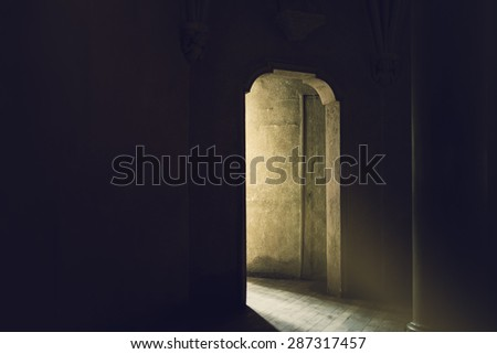 Mystic Gothic Door with Sunlight Entering Dark Room, Exit to Light, Hope and New Beginning Concept, Vintage Retro Tone Effect - stock photo