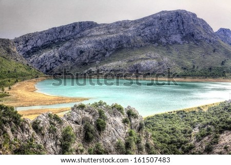 Mystic lake in Majorca mountains - stock photo