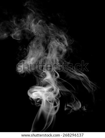 mystic smoke on black background - stock photo