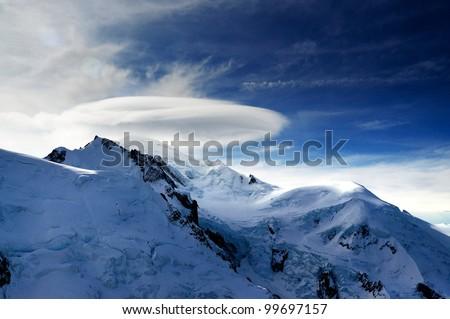 mystical cloud on snow mountain - stock photo