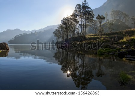 Mystical forest and lake at Mount Rinjani, Indonesia. - stock photo