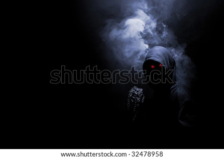 Mystical monk with chain on the hand - stock photo