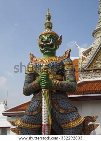 Mythical giant guarding the gate of Temple of the Emerald Buddha, Bangkok, Thailand - stock photo
