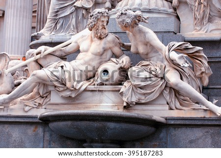 Mythology fountain on the front of Vienna parliament in Austria. - stock photo