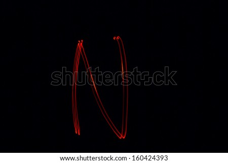 N - torch light alphabet letters - stock photo