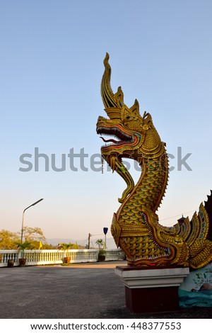 Na-ga  statue in temple, Nan, northern of Thailand ,blue sky  - stock photo