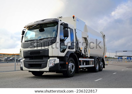 NAANTALI, FINLAND - OCTOBER 11, 2014: Volvo FE Euro 6 refuse truck parked. Volvo FE is a truck used for city or regional distribution, light construction, utilities and refrigerated transport jobs.  - stock photo