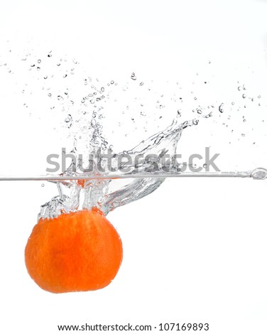 naartjie falling in water - stock photo